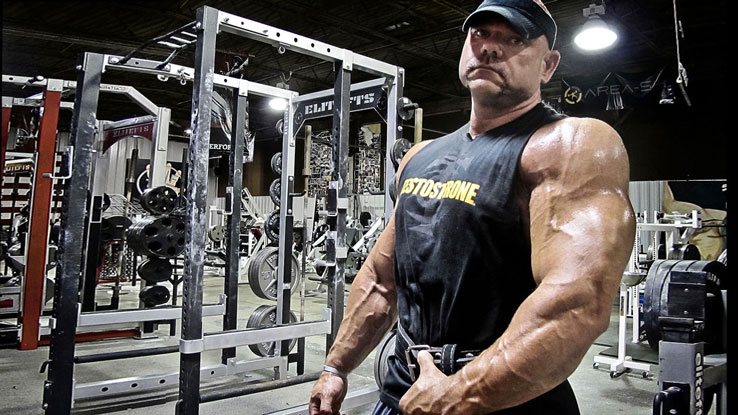 Dave Tate in gym with pumped arms